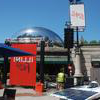 Chicago Cloud Gate sculpture (AKA The Bean) with Illini Fest event signs in the foreground